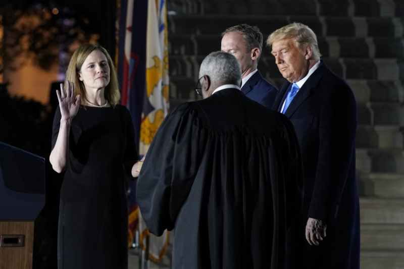 Amy Barrett  J.  sworn in by Clarence Thomas and The Occupant.