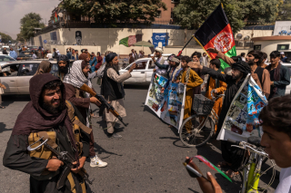 Taliban. Protestors With Afghan Flag Face Fighters With Guns in Kabul.  (Victor J. Blue  . New York Times)
