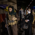 Taliban . Taliban and Woman Reporter on Patrol in Kabul early in the occupation. (Jim Huylebroek . New York Times)