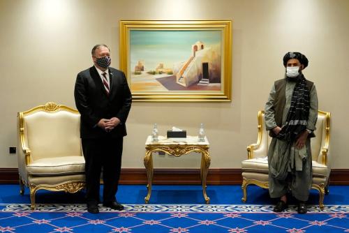 Taliban . Pompeo and Taliban Mullah Barradar in Doha.  (Patrick Semansky . Associated Press)